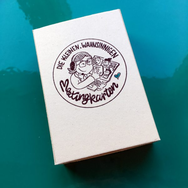 Die kleinen, wahnsinnigen Meetingkarten kommen in einem Schuber